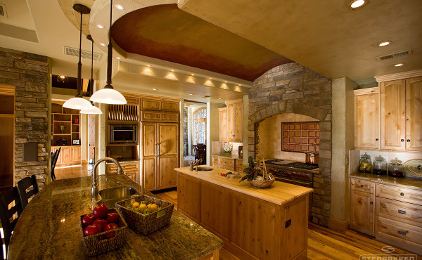 Designer kitchen with wood, stone and hanging lights
